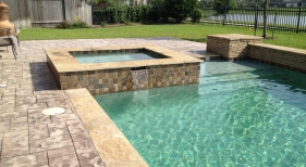 Geometric Pool and Spa with Spillover and Tanning Ledge