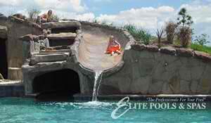 grotto, slide elite pools of houston pool design