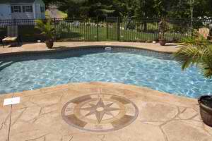 Luxury-pool-with-concrete-emblem-300x200