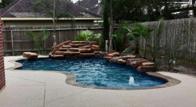 Freeform Pool with Bubbler and Rock Waterfall