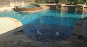 Freeform Pool and Spa with Tanning Ledge and Bubblers