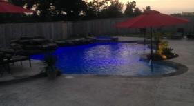 Freeform Pool and Pa with Rock Waterfall and Tanning Ledge