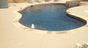 Freeform Pool and Spa with Spillover and Bubbler