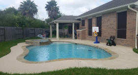 Freeform Pool and Spa with Patio Cover