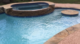 Freeform Pool and Spa with Cocktail Table