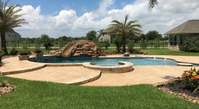 Freeform Pool and Spa with Tanning Ledge, Bubblers and Slide