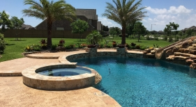 Freeform Pool and Spa with Spillover and Slide