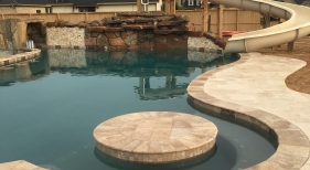 Freeform Pool with Rock Waterfall and Cocktail Table