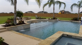 Geometric Pool and Spa with Bubblers, Sheer Descent and Tanning Ledge
