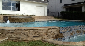 Freeform Pool and Spa with Bubblers and Tanning Ledge
