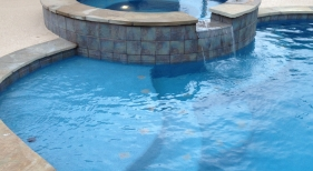Freeform Pool and Spa with Spillover and Tanning Ledge