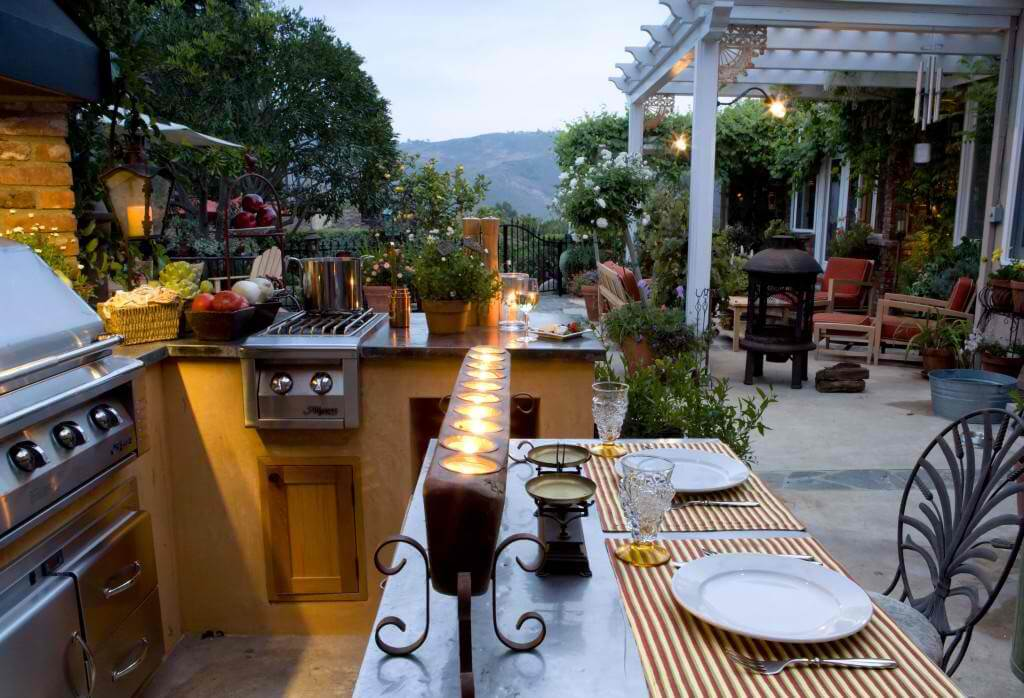 A beautiful outdoor kitchen with bar seating.